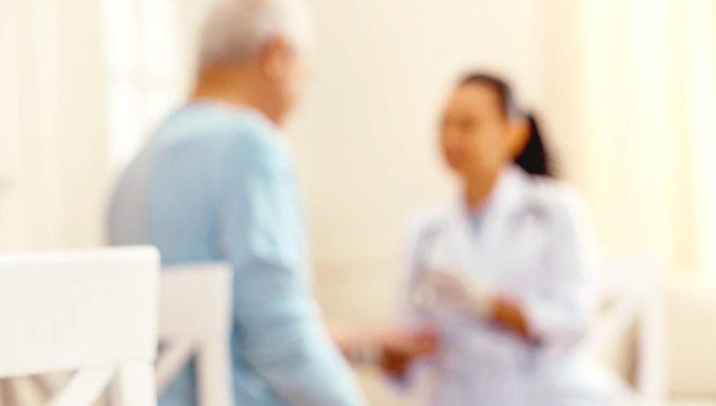 Caregiver Administering Medicine